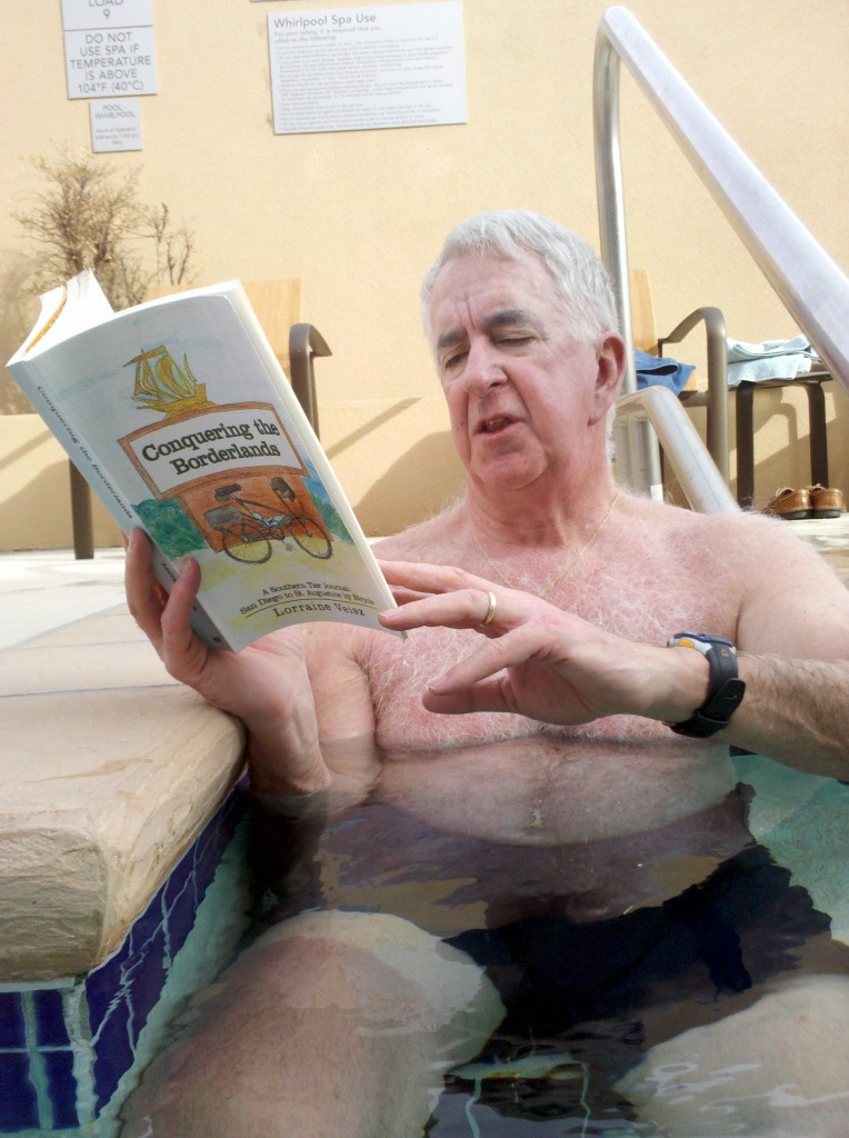 "Tim reading ""Conquering the Borderlands"" while relaxing in hotel hot tub."