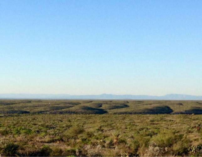 Another blue sky day in the cold morning air as we pedal along the expansive wide open range.