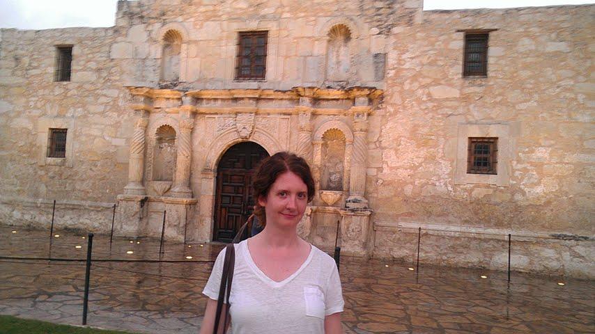 Beth in front of the Alamo, San Antonio, TX.
