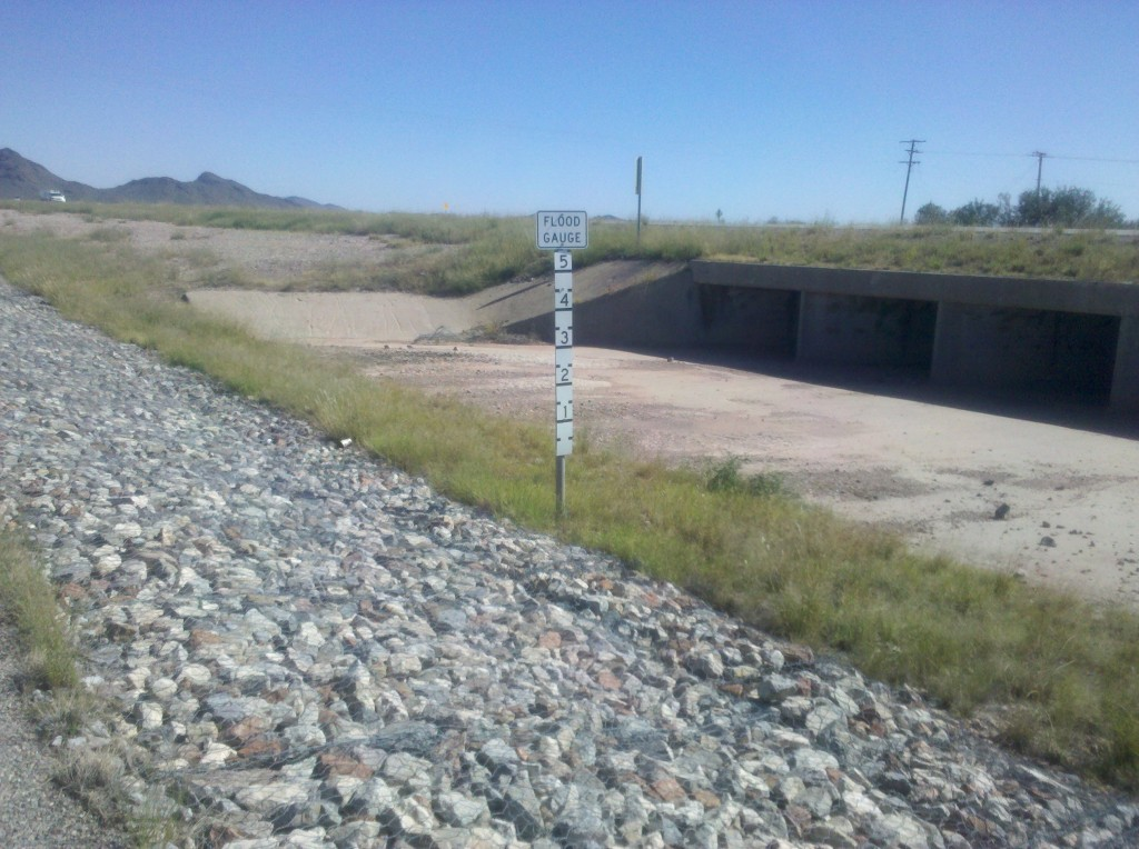 """Several times today we saw signs saying """"Watch for Water in the Road."""" Apparently, when it rains here, it really rains.  Here is a Flood Gauge sign along I-10 Business East, that can show how high the water in the road can get.  There are some months of the year when you definitely could not do this bike trip."""