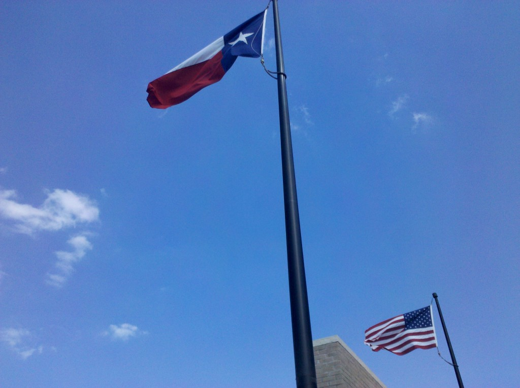 Texas and U.S. flags blowing in the direction we rode today.  Often in Texas, the state flag is somewhat larger than the U.S. flag (since Texas was a republic before it was a U.S. state), but these flags look to be the same size.