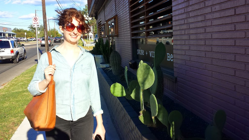 Beth standing next to Prickly Pear cactus at the Salty Sow restaurant in Austin