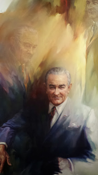 LBJ portraits on the 10th floor, just outside the reproduction of the oval office.