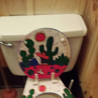 Toilet seat in Men's room - that's right the MEN'S ROOM - in Los Patrones Restaurant, Round Top, TX