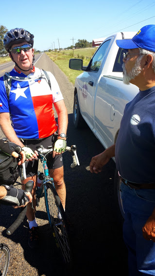 Tim talking to Ernie Bazan, who stopped to talk to us along TX 105 East on the way into Navasota.  Ernie runs a motel/campsite that caters to bikers doing the Southern Tier route.