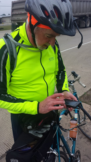 Tim checking directions on his phone not too far out of Conroe.  It isn't even 30 degrees at this point in the ride!