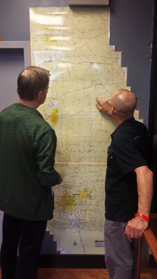 Mark and Bike Store Owner Mike discuss tomorrow's route to Poplarville, MS