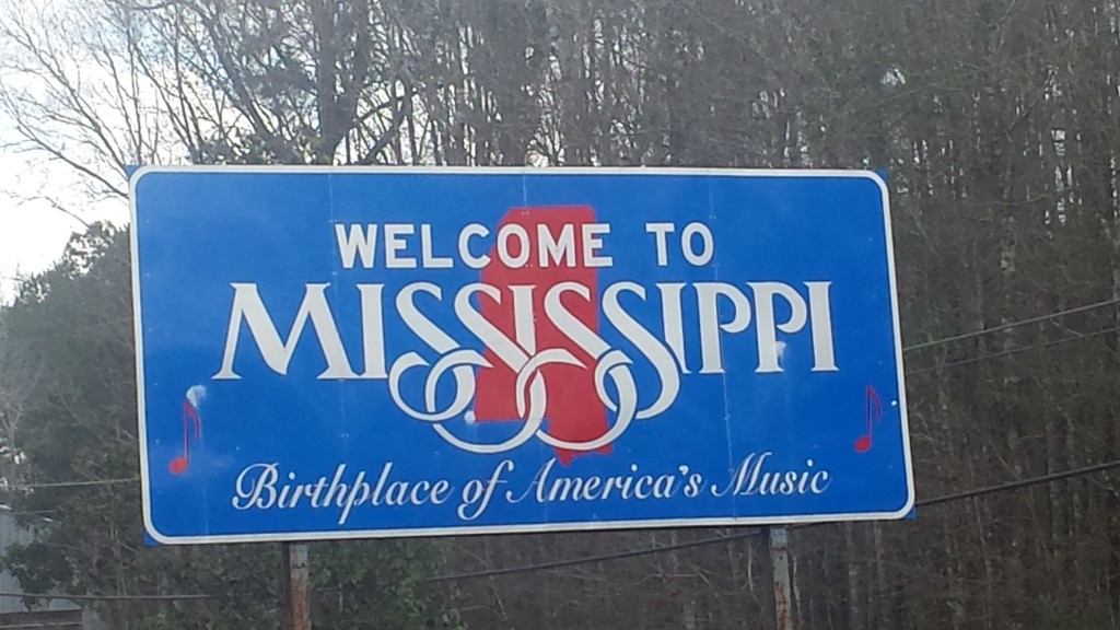Welcome to Mississippi sign along MS 26.  I certainly didn't know that Mississippi was the birthplace of America's music.  Do the people in New Orleans know that?