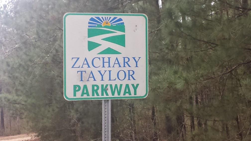 "Zackary Taylor Parkway sign along LA 10.  During the ride Matt asked if any of us knew Zachary Taylor's nickname.  I looked it up on Wikipedia and it is ""Old Rough and Ready.""  Taylor was the last U.S. President to own slaves.  Does anyone know why LA 10 is also named Zachary Taylor Parkway?"