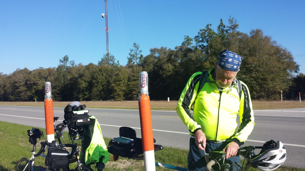 Tim at our first stop of the day at Mossy Head, FL on S 90. Notice the Coors Light beer cans ducktaped to the orange gas line markers.