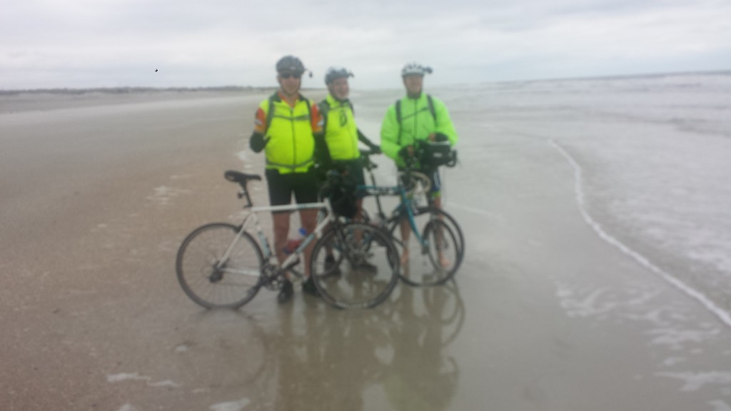 The brothers dipping our bike tires into the Atlantic Ocean at St. Augustine Beach.