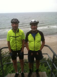 Brian and Tim in Germany with the Baltic Sea in the background.
